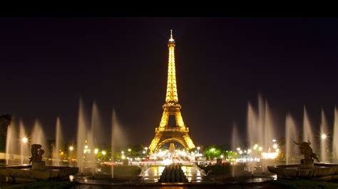 Paris Eiffel Tower With Yellow Lights And Water Fountain